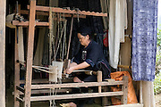 Black Hmong woman weaving on a loom in Cat Cat village, Sapa, Vietnam, Asia