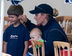 Zara Phillips' baby Mia plays with her cousin James Viscount Severn (daughter of Sophie and Prince Edward) during lunch at Gatcombe this afternoon. Image ©Licensed to i-Images Picture Agency. 02/08/2014. Minchinhampton, United Kingdom. Gatcombe Festival of Eventing. Gatcombe Park. Picture by i-Images