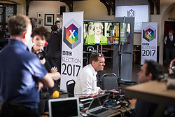 © Licensed to London News Pictures. 31/05/2017. Cambridge, UK. Prime Minister Theresa May is seen on TV screens in the spin room for the BBC General Election Debate. May has refused to take part in the televised debate. Photo credit: Rob Pinney/LNP