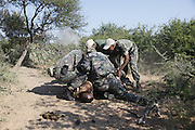 Nkwe wildlife security services offer a paramilitary - style rhino protection service that operates in the several private game reserves in the Limpopo area of South Africa..Nkwe's recruits undergo a basic two week training program focusing on military discipline and endurance to become a field ranger. From this stage the field rangers may be selected for an advance course that focuses on firearms and tactical training. Once this is completed they will be given rank and go on armed patrol to protect the rhinos...Pic shows: A mock-up demonstration of how the corporals and field rangers work when they discover a rhino poacher...Nkwe Wildlife Security Services based in the Lapalala Wilderness Area, Limpopo, South Africa...© Zute Lightfoot