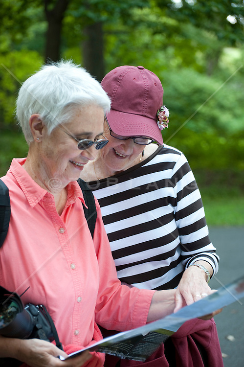 two women reading a map outdoors