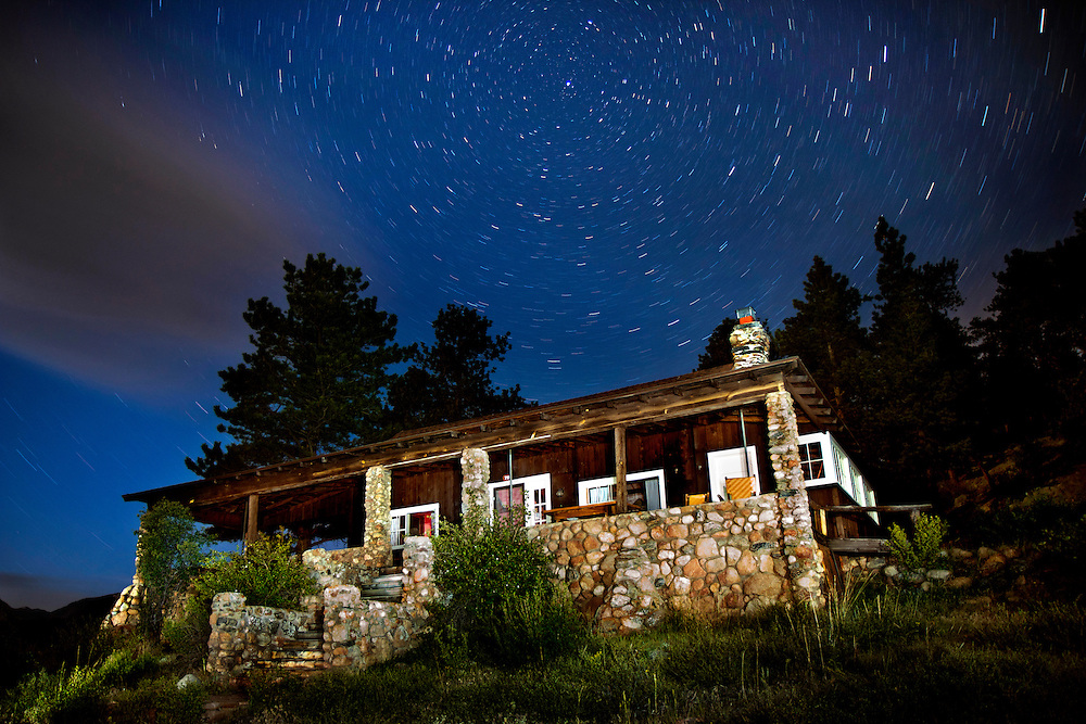 The North Star shines above the William Allen White Cabin in Rocky Mountain National Park, Colorado. Rocky Mountain National Park celebrates it's 100th Anniversary  in 2015.