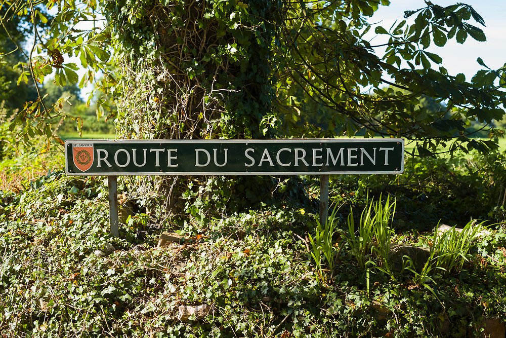 Route du Sacrement, French road name sign in St Saviour region of Jersey, Channel Isles