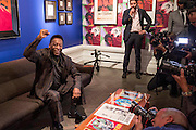 "UNITED KINGDOM, London: 22 September 2015 Legendary footballer Pele sits in front of a painting entitled ""Pele"" (Andy Warhol, 1977) in the Halcyon Gallery, New Bond Street, as he launches the ""Art, Life, Football"" exhibition - in celebration of Pele's 75th birthday and a lifetime of sporting and humanitarian achievements. The exhibition opens on October 18th and includes photography, paintings and sculptures by the likes of Andy Warhol and Ronnie Wood. <br /> Credit: Story Picture Agency"