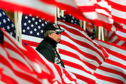War veteran, Walter Matjasich, a member of the motorcycle club known as the Patriot Guard, stands watch during the funeral of U.S. Army Pfc. Aaron Nemelka, Saturday,  Nov. 14, 2009 in West Jordan, Utah. Nemelka was one of 13 gunned down at Fort Hood, Texas. (AP Photo/Colin Braley)