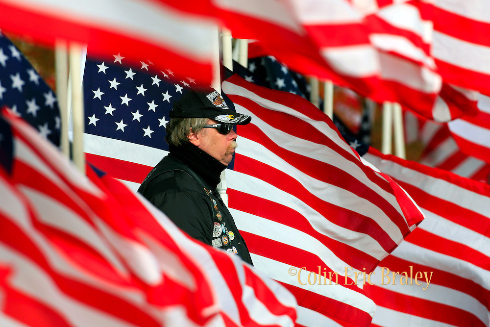 War veteran, Walter Matjasich, a member of the motorcycle club known as the Patriot Guard, stands watch during the funeral of U.S. Army Pfc. Aaron Nemelka, Saturday,  Nov. 14, 2009 in West Jordan, Utah. Nemelka was one of 13 gunned down at Fort Hood, Texas. (AP Photo/Colin Braley)
