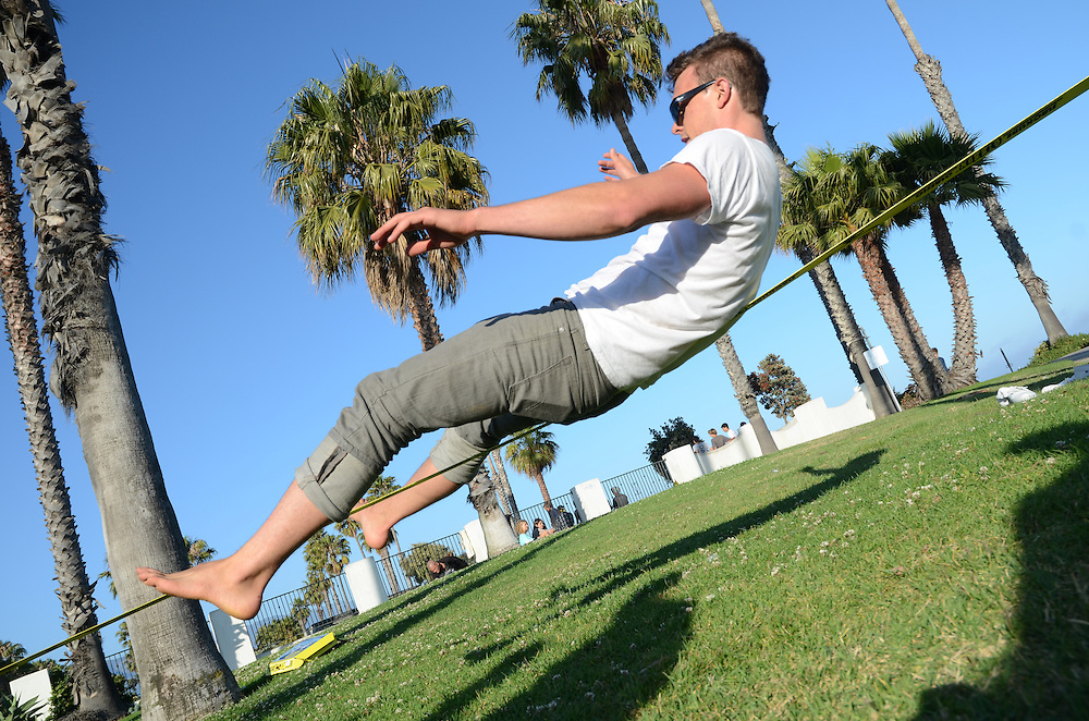 Man slacklining at Cabrillo Park in Santa Barbara, California, USA, North America