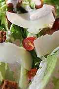 Italian style fresh green salad with tomatoes bread croutons and Parmesan Cheese