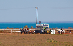 Horses in the 2012 Kimberley Cup leave the starting gates of the Broome racetrack at Gantheume Point.