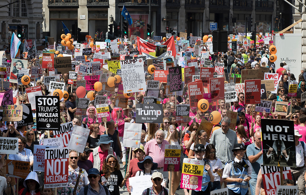© Licensed to London News Pictures. 13/07/2018. London, UK. Demonstrators march to Whitehall in protest of President Trump's visit.. President Trump is on the second day of a four day visit to the UK. Photo credit: Peter Macdiarmid/LNP