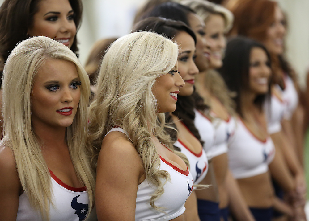 4/16/2014: Girls wait nervously to hear their names being called out. Fifty girls showed up on April 16, 2014 at the Houston Texans practice facility in Houston, Texas to see which 35 girls made the 2014-2015, Houston Texans Cheerleading Team.