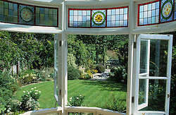 Looking out through the kitchen window to the circular lawn and garden