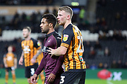 Hull City defender Stephen Kingsley (23) marking Swansea City midfielder Wayne Routledge (15)  during the EFL Sky Bet Championship match between Hull City and Swansea City at the KCOM Stadium, Kingston upon Hull, England on 22 December 2018.