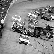 Joey Logano (20) bounces off the wall and crashes into Clint Bowyer (33) on the final lap of NASCAR Nationwide Series at Dover International Speedway in Dover Delaware.<br />