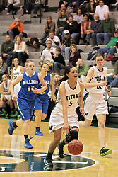 15 January 2014:  Kasey Reaber, Shelby Jackson & Yip Ypya during an NCAA women's division 3 basketball game between the Millikin Big Blue and the Illinois Wesleyan Titans in Shirk Center, Bloomington IL