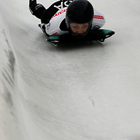 27 February 2007:  Katie Uhlaender of the United States slides through turn 13 and a 7th place finish in the 4th run at the Women's Skeleton World Championships competition on February 27 at the Olympic Sports Complex in Lake Placid, NY.