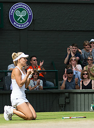 LONDON, ENGLAND - Thursday, July 7, 2016:  Angelique Kerber (GER) let's go of her racquet and falls to the ground after winning the Ladies' Singles - Semi-finals match on day eleven of the Wimbledon Lawn Tennis Championships at the All England Lawn Tennis and Croquet Club. (Pic by Kirsten Holst/Propaganda)