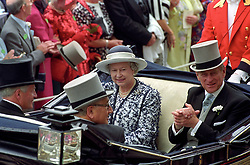 File photo dated 20/06/95 of Queen Elizabeth II and the Duke of Edinburgh riding down the course at Ascot. The Royal couple will celebrate their platinum wedding anniversary on November 20.