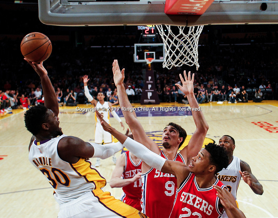 Los Angeles Lakers forward Julius Randle (#30) shoots against Philadelphia 76ers during an NBA basketball game Tuesday, March 12, 2017, in Los Angeles. <br /> (Photo by Ringo Chiu/PHOTOFORMULA.com)<br /> <br /> Usage Notes: This content is intended for editorial use only. For other uses, additional clearances may be required.