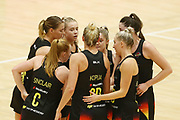 The Magic with a team huddle. 2018 ANZ Premiership netball match, Stars v Magic at Pulman Arena, Auckland, New Zealand. 27 May 2018 © Copyright Photo: Anthony Au-Yeung / www.photosport.nz