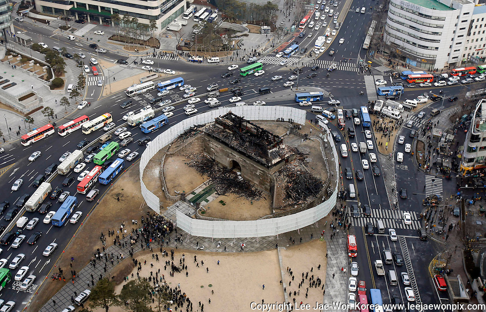"""An aerial view of the destroyed Namdaemun, or """"Great South Gate"""", in Seoul February 11, 2008. The 600-year-old gate in central Seoul listed as South Korea's number one national treasure and the country's landmark symbol has been destroyed, possibly by an arsonist, police said. /Lee Jae-Won"""
