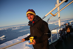 ATLANTIC OCEAN ABOARD ARCTIC SUNRISE 31MAY11 - Assistant engineer Daniel 'Donci' Szonyi of Hungary aboard the Greenpeace Ship Arctic Sunrise in the Arctic sea ice during sunset in the Labrador Sea.....jre/Photo by Jiri Rezac / Greenpeace