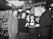 05/01/1989.01/05/1989.5th January 1989.The Aer Lingus Young Scientist of the Year Award at the RDS, Dublin..Picture shows Michael Smith, T.D., Minister for Energy with Fiona Steed and Frances Quinn from St. Mary's Secondary School, Nenagh, Co. Tipperary at their project 'Greyhounds- A Hobby or an Enterprise'. Anne O'Reilly of Aer Lingus is also in picture.