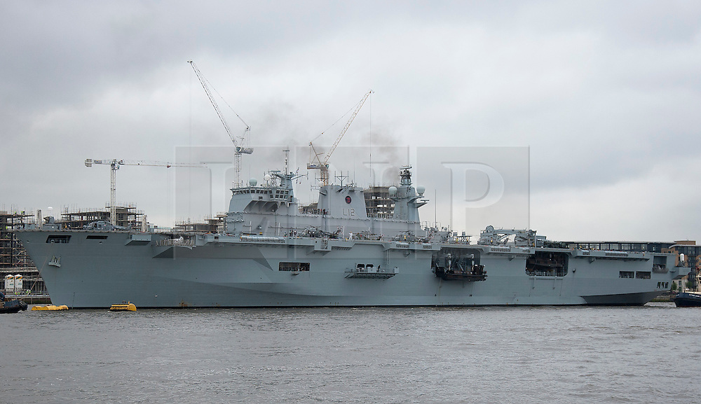 © Licensed to London News Pictures. 04/05/2012. LONDON, UK. The Royal Navy's helicopter carrier, HMS Ocean, is moored at Greenwich, London, after making her way up the Thames today (04/05/12). HMS Ocean has been deployed as part of an exercise involving the RAF, British Army and Royal Navy taking place across London as part of security preparations for the 2012 London Olympic Games. Photo credit: Matt Cetti-Roberts/LNP