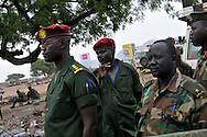 SPLA officers observe a large, open terrain just opposite John Garang's tomb in Juba where hundreds of unexploded ordinance were found scattered across the area as it was being prepared for South Sudan independence ceremonies. The Government of South Sudan called on Mines Advisory Group (MAG) to assist SPLA deminers in an attempt to clear the area and make it safe for the thousands of people and dignitaries who will be attending the declaration of independence on July 9th...Juba, South Sudan. 04/07/2011..Photo © J.B. Russell