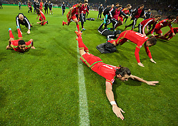 ZENICA, BOSNIA & HERZEGOVINA - Saturday, October 10, 2015: Wales' Gareth Bale and players celebrate qualifying for the Euro 2016 finals despite a 2-0 defeat to Bosnia and Herzegovina during the UEFA Euro 2016 qualifying match at Stadion Bilino Polje. (Pic by David Rawcliffe/Propaganda)