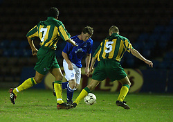WIDNES, ENGLAND - Tuesday, March 11, 2003: Everton's Wayne Rooney tries to get past West Brom Tamika Mkandawire (l) and Ross Adams (r) during the Premier Reserve League (Northern Division) at the Halton Stadium. (Pic by David Rawcliffe/Propaganda)