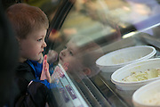 Corbin Andrysiak, 3, checks out the available flavors at the seventh annual Ice Cream for Breakfast fundraiser at Moonlight Creamery in Fairport on Saturday, February 7, 2015.