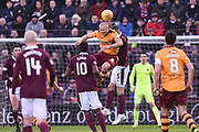 Curtis Main beats Aaron Hughes to the ball during the Ladbrokes Scottish Premiership match between Heart of Midlothian and Motherwell at Tynecastle Stadium, Gorgie, Scotland on 27 January 2018. Photo by Kevin Murray.