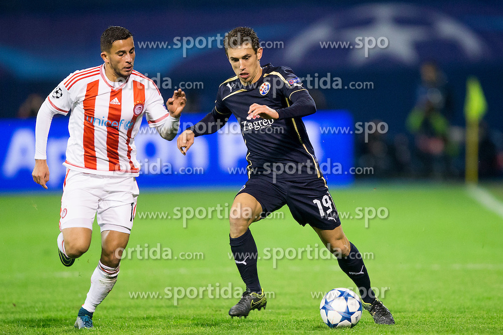 Pajtim Kasami #11 of Olympiakos and Josip Pivaric #19 of GNK Dinamo Zagreb during football match between GNK Dinamo Zagreb and Olympiakos in Group F of Group Stage of UEFA Champions League 2015/16, on October 20, 2015 in Stadium Maksimir, Zagreb, Croatia. Photo by Urban Urbanc / Sportida