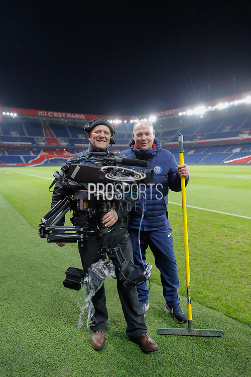 Broadcasting steadicamer Bruno Vilde and chief gardener Jonathan Calderwood (PSG) are pictured at the end of the game during the French Championship Ligue 1 football match between Paris Saint-Germain and ESTAC Troyes on November 29, 2017 at Parc des Princes stadium in Paris, France - Photo Stephane Allaman / ProSportsImages / DPPI