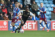 Drissa Traore (7) of Swindon Town gets away from Paddy Madden of Scunthorpe United  during the Sky Bet League 1 match between Scunthorpe United and Swindon Town at Glanford Park, Scunthorpe, England on 28 March 2016. Photo by Ian Lyall.