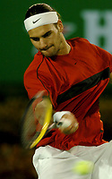 MELBOURNE, AUSTRALIA - JANUARY 30: Roger Federer in action during day 12 of the Australian Open January 30, 2004 in Melbourne, Australia. (Photo by Sportsbeat) *** Local Caption *** -