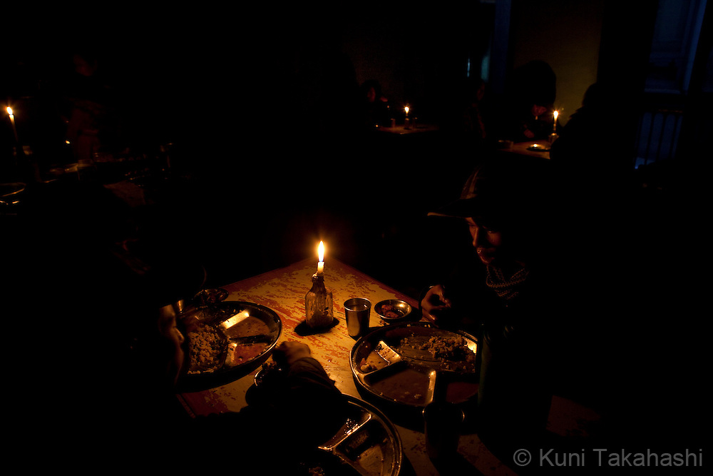 (Jan 4, 2012 - Kathmandu, Nepal).Restaurant uses candle lights during power outage in Kathmandu, Nepal, on Jan 4, 2012. For the last several years, nearly 800,000 people of the capital city faced up to 16 hours of blackouts every day, mainly caused by political instability. Nepal is said to be second only to Brazil in terms of water resources but the government has been incapable of harnessing hydropower..(Photo by Kuni Takahashi)
