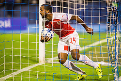 Theo Walcott #14 of Arsenal F.C. scores a goal  during football match between GNK Dinamo Zagreb, CRO and Arsenal FC, ENG in Group F of Group Stage of UEFA Champions League 2015/16, on September 16, 2015 in Stadium Maksimir, Zagreb, Croatia. Photo by Ziga Zupan / Sportida