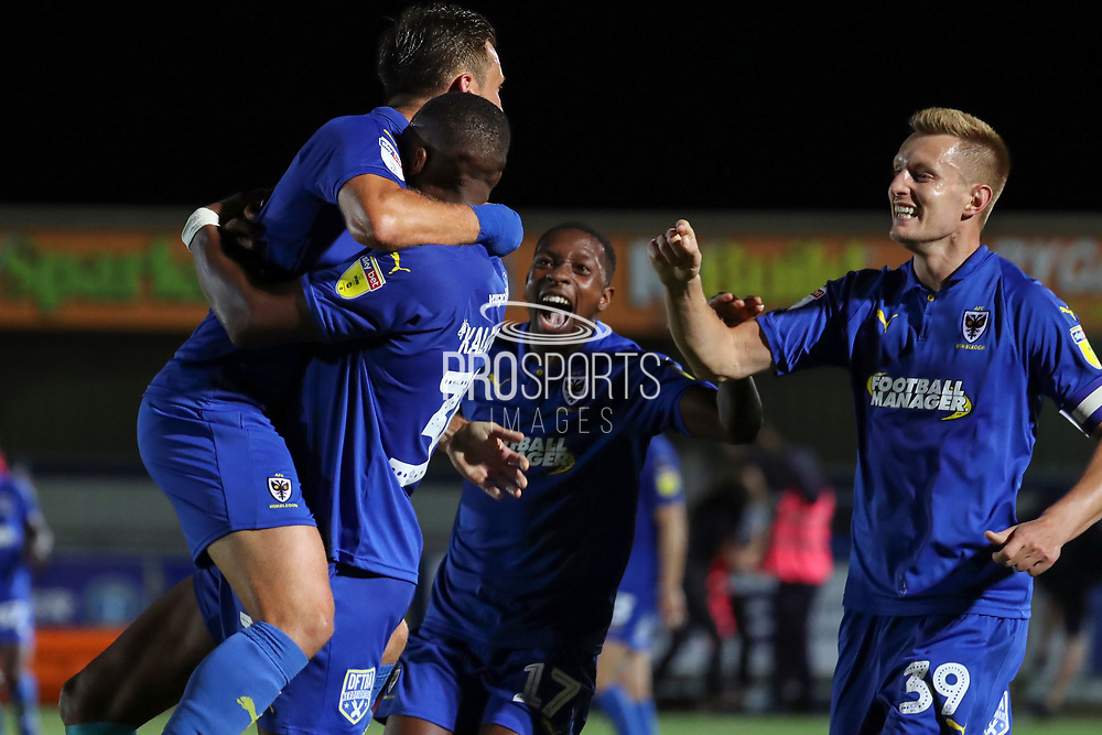 AFC Wimbledon defender Luke O'Neill (2) celebrating after scoring goal during the EFL Cup match between AFC Wimbledon and Milton Keynes Dons at the Cherry Red Records Stadium, Kingston, England on 13 August 2019.