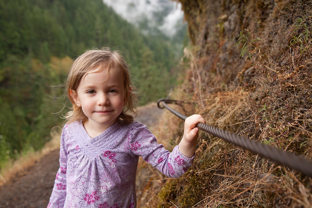 Girl holding a cable hiking.