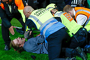 Stewards wrestle a pitch invader to the ground during the EFL Sky Bet League 2 match between Notts County and Coventry City at Meadow Lane, Nottingham, England on 18 May 2018. Picture by Simon Davies.