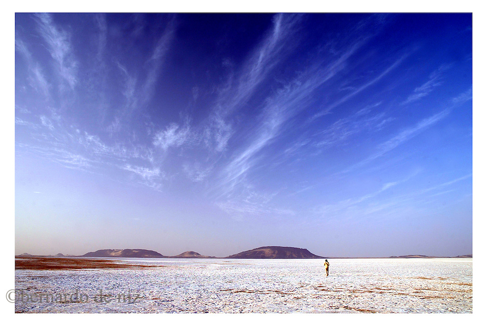 Belga Mohamed Brahim, an old beduin walks on a sea of salt in the border between Mauritania and The Sahrawi Arab Democratic Republic´s liberated territories. on January 2005. (Photo by Bernardo De Niz)