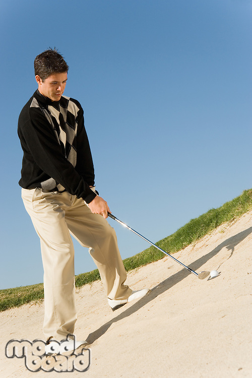 Young Man in Sand Trap