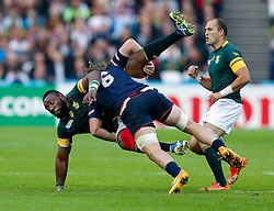 South Africa Prop Tendai Mtawarira is tackled by USA Flanker Danny Barrett - Mandatory byline: Rogan Thomson/JMP - 07966 386802 - 07/10/2015 - RUGBY UNION - The Stadium, Queen Elizabeth Olympic Park - London, England - South Africa v USA - Rugby World Cup 2015 Pool B.