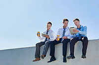 Photo of thoughtful businessmen sitting and relaxing on rooftop