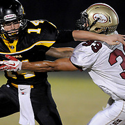 Topsail's Nick Altilio rushes agaings Ashley's Anthony Boone. (Jason A. Frizzelle) After graduating from Randolph Community College I spent more than a decade documenting communities throughout Eastern North Carolina with a camera. My passion for capturing story-telling images has allowed me to witness everything from High School Football to Hurricanes and even Presidential visits.<br />