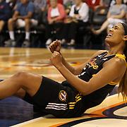 Skylar Diggins, Tulsa Shock, reacts after being fouled while scoring a basket during the Connecticut Sun Vs Tulsa Shock WNBA regular season game at Mohegan Sun Arena, Uncasville, Connecticut, USA. 3rd July 2014. Photo Tim Clayton