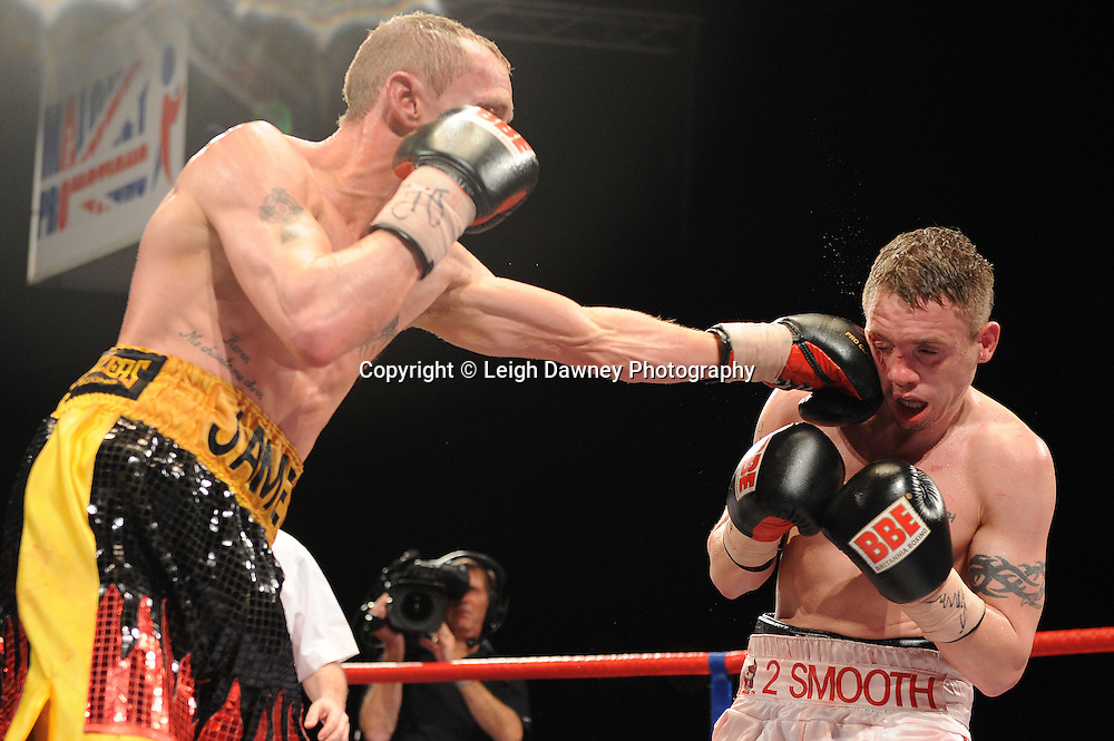 Jason Booth (white shorts) defeats Jamie Arthur for the British & Commonwealth Super Bantamweight Title at Brentwood Centre, Brentwood, Essex on the 5th February 2011. Frank Maloney Promotions. Photo credit © Leigh Dawney