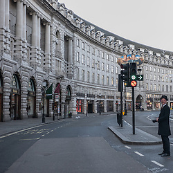 London, UK - 25 December 2014: a man stands in Regent's Street on Christmas morning.